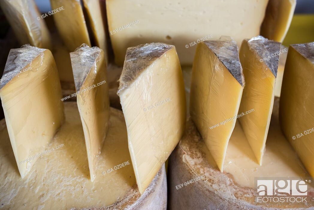 Stock Photo: Traditional Old Sliced Turkish Kars cheddar cheese and cheese blocks are for sale on merchant.