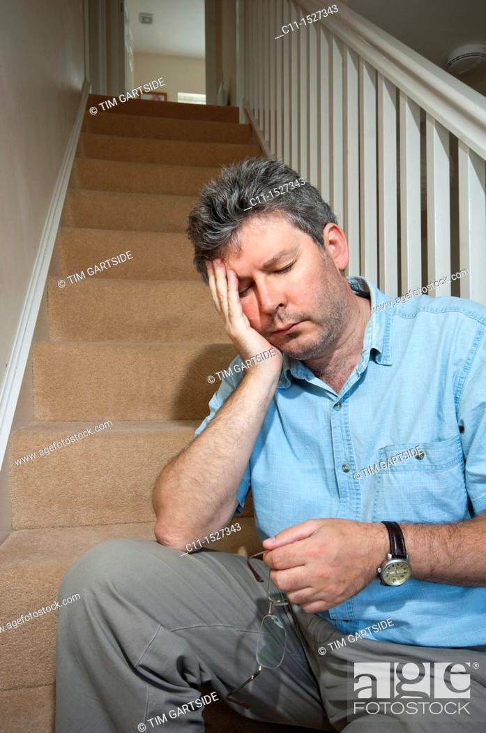 Stock Photo: middle aged man feeling depressed.