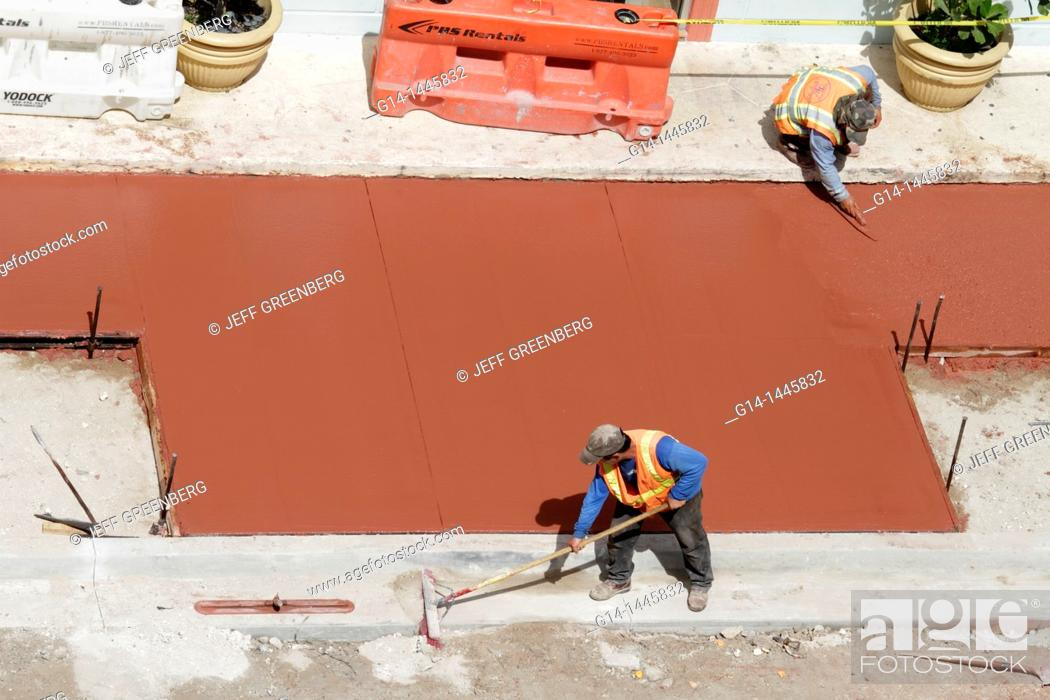 Stock Photo: Florida, Miami Beach, 'Ocean Drive', construction, renovation, repair, city street, replacement, man, men, worker, fresh red cement, sidewalk, aerial view, road.