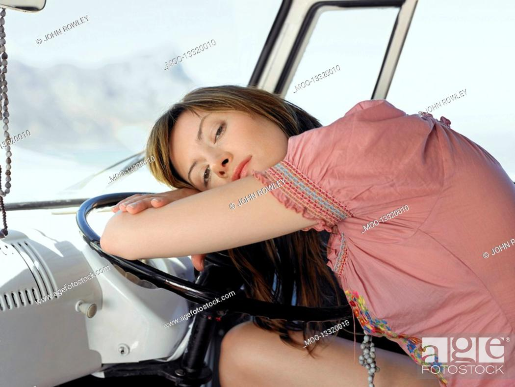 Stock Photo: Woman Resting on Steering Wheel in van half length.
