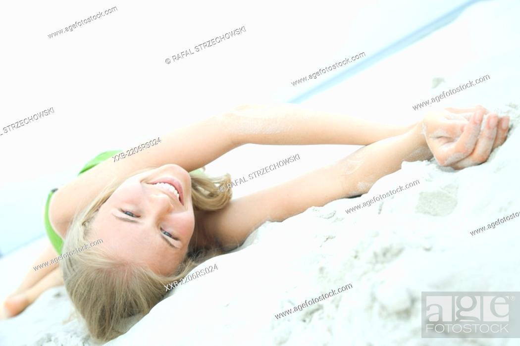 Stock Photo: smiling woman lying on beach.