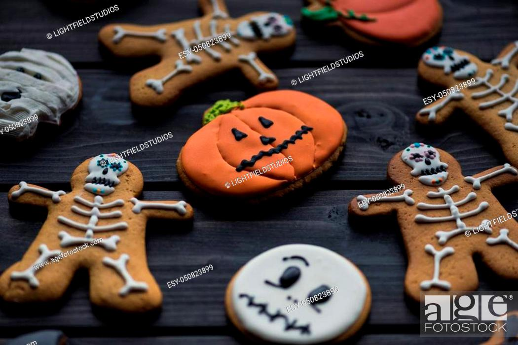 Stock Photo: composition of homemade halloween cookies on black table.