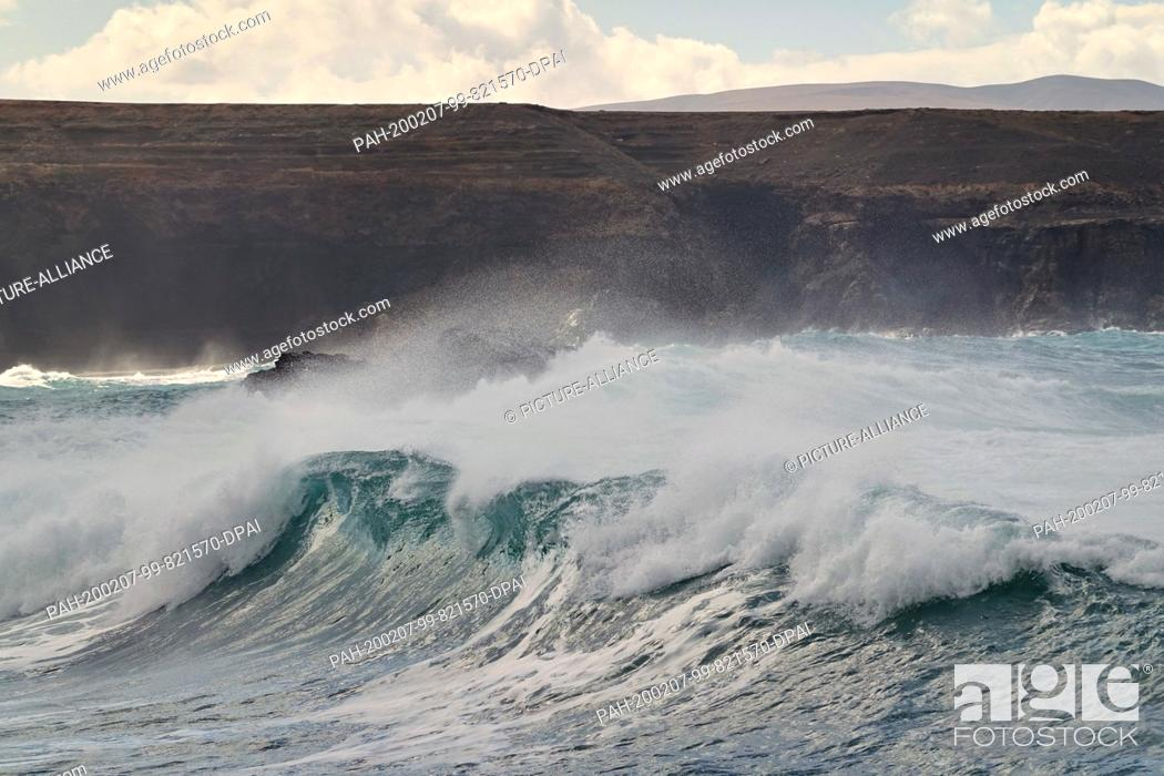 Stock Photo: 06 December 2019, Spain, La Pared: The surf on the rocks on the Atlantic coast in the west of the island. Photo: Soeren Stache/dpa-Zentralbild/ZB.