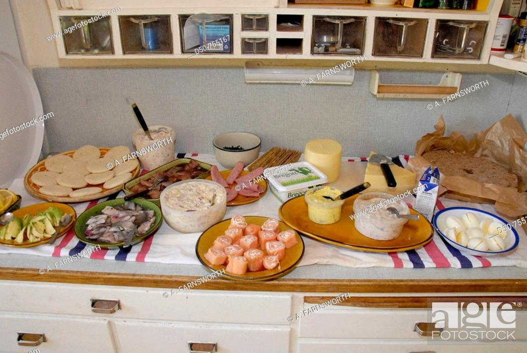 Stock Photo: Traditional midsummer buffet with herring, egg and salmon, cheese and hard bread or crackers. Medevi, Sweden.