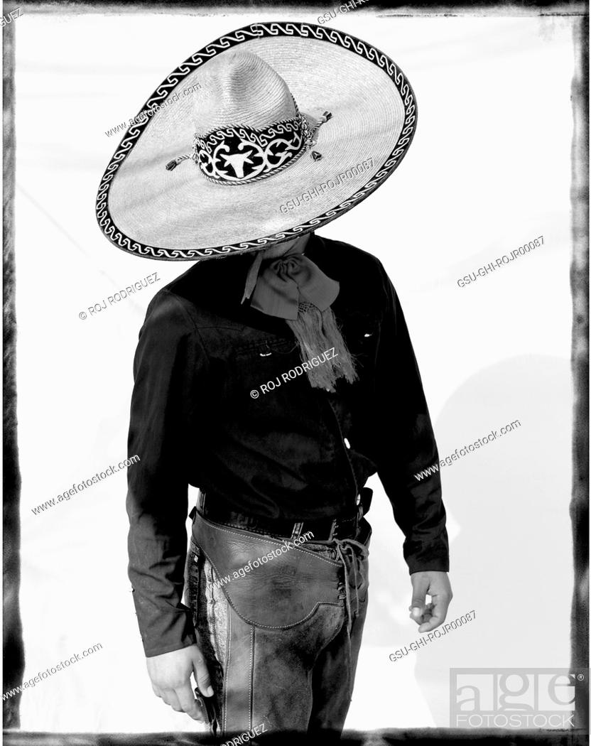 Stock Photo - Mexican Cowboy With Large Brim Hat Looking Down c912b06e9bd