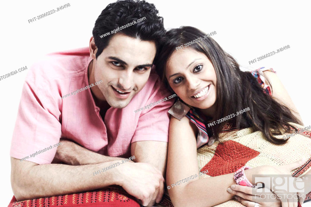 Stock Photo: Portrait of a young couple lying on the floor and smiling.