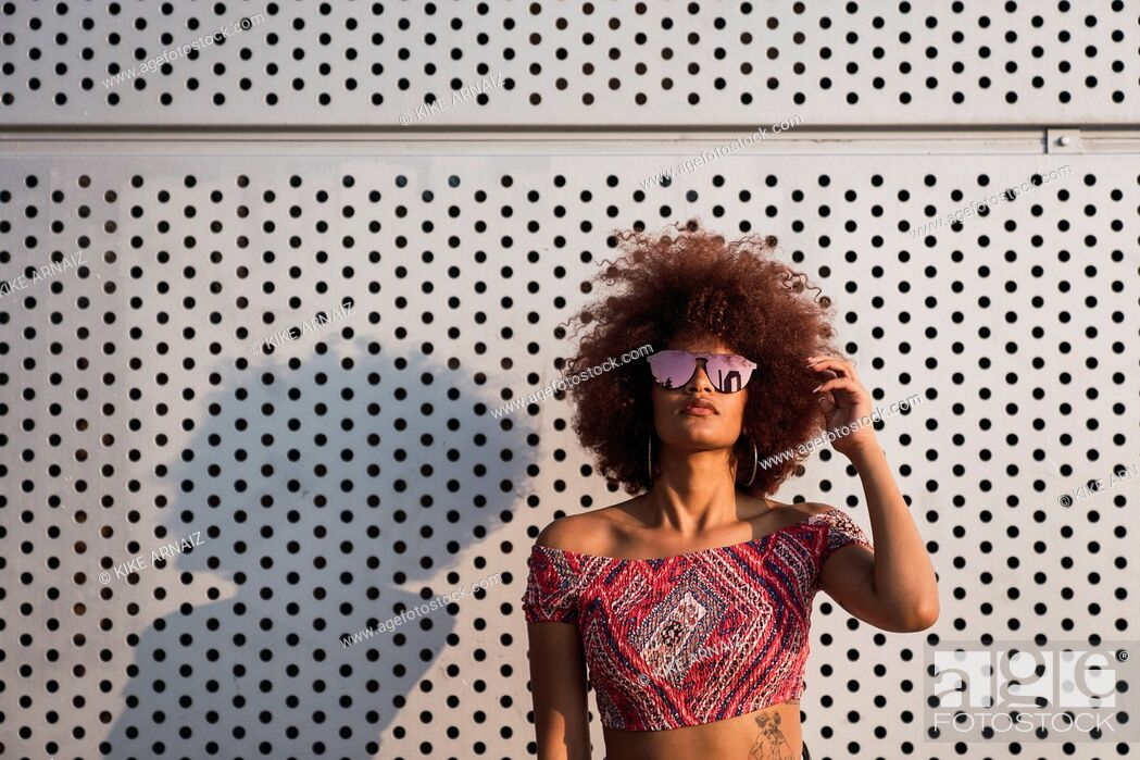 Stock Photo: Portrait of fashionable woman wearing mirrored sunglasses.