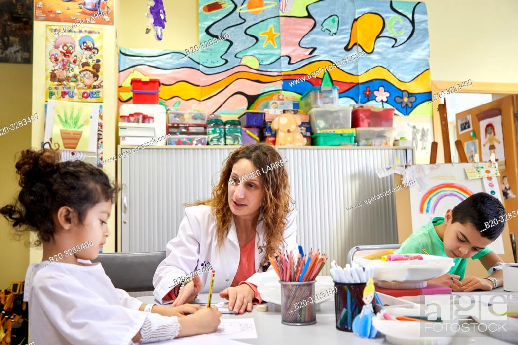 Stock Photo: Teacher with children in a classroom of studies and games, Plant for hospitalization of children, Pediatrics, Medical care, Hospital Donostia, San Sebastian.