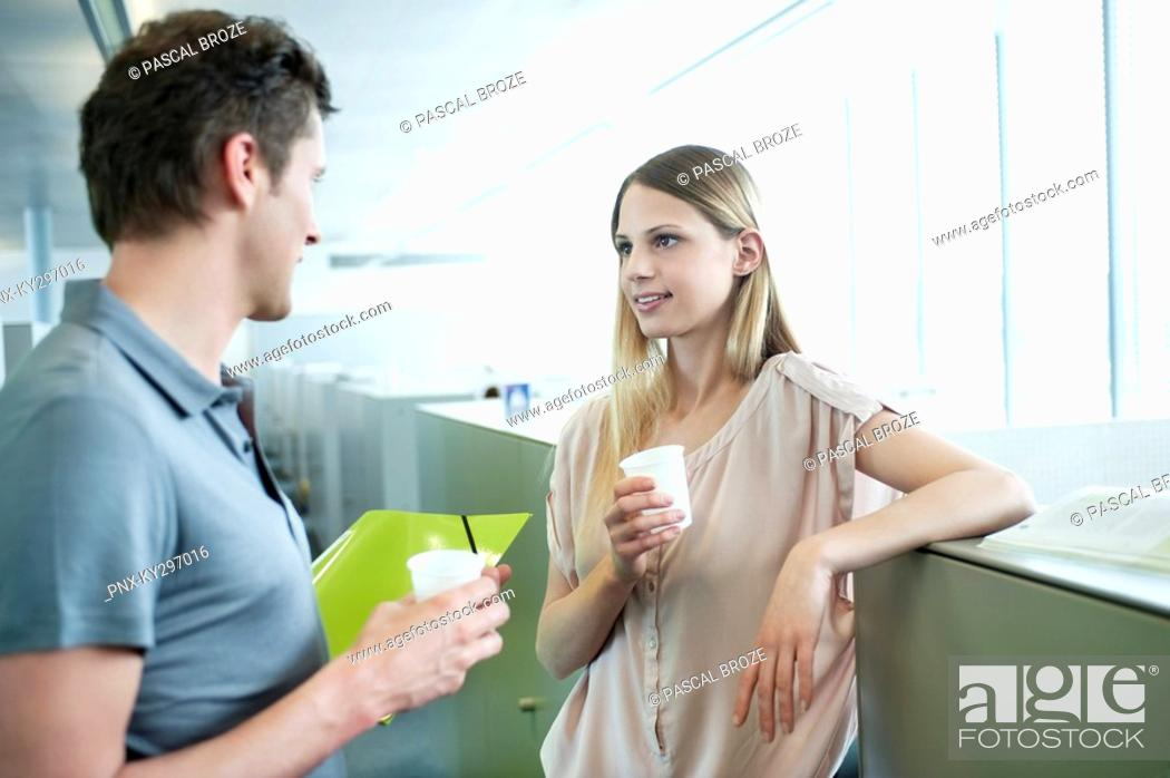 Stock Photo: Business executives in an office during a coffee break.