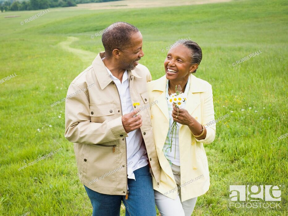 Stock Photo: Close-up of a senior man and a senior woman smiling.