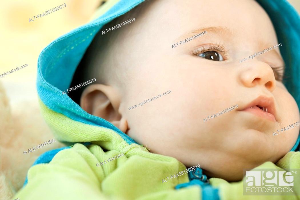 Stock Photo: Infant wearing hooded sweatshirt, close-up.