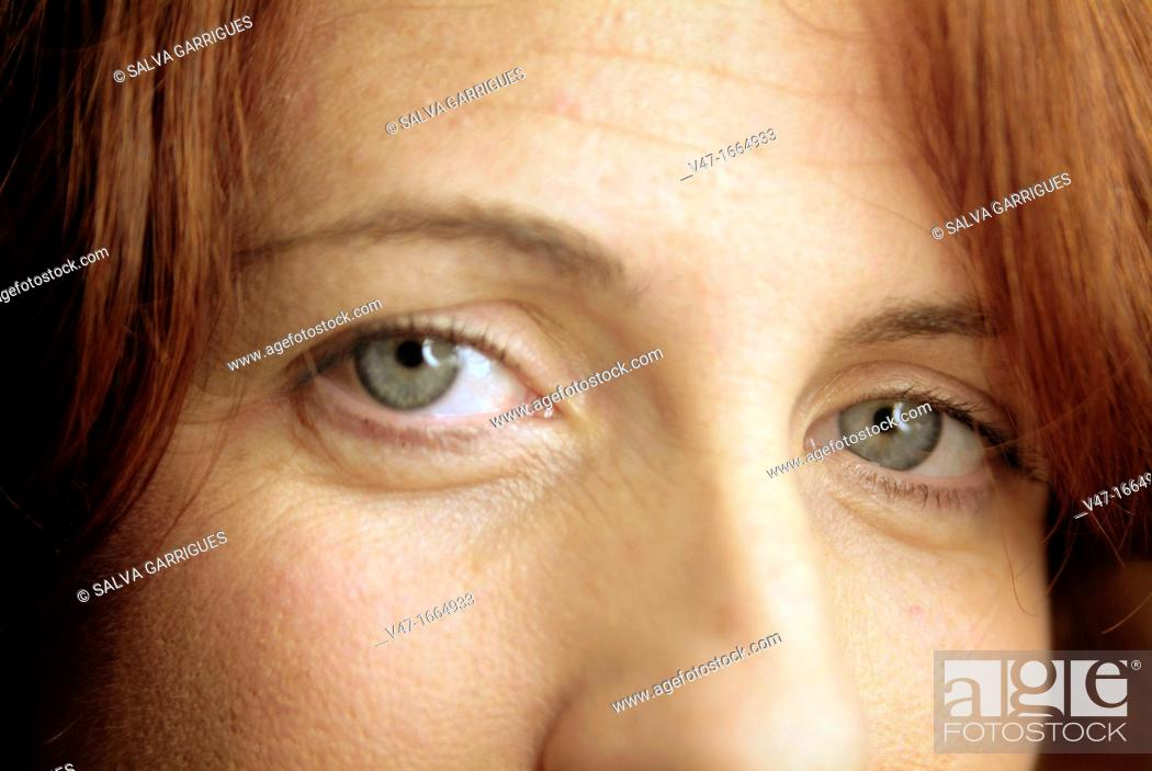 Stock Photo: redhead girl with gray eyes.
