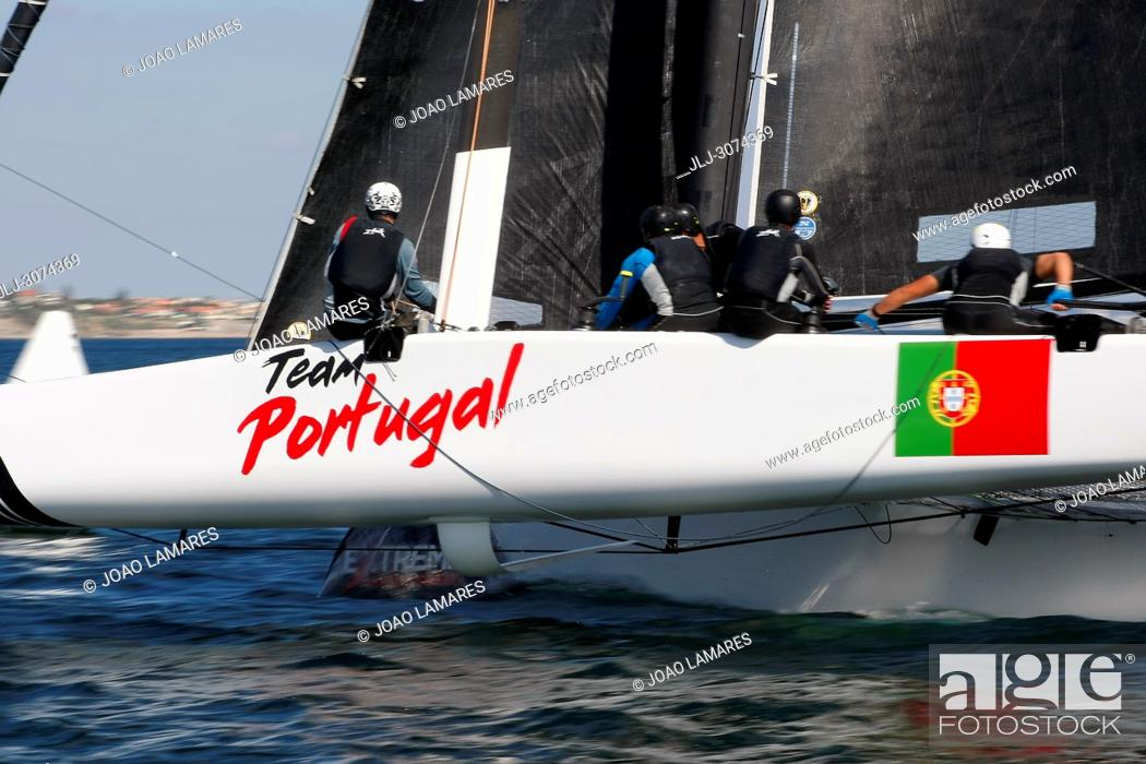 Stock Photo: Sailing: Team Portugal with Luis Brito and Henrique Brites as a skippers. Extremesailing round 4 at Baia de Cascais, Cascais, Portugal.