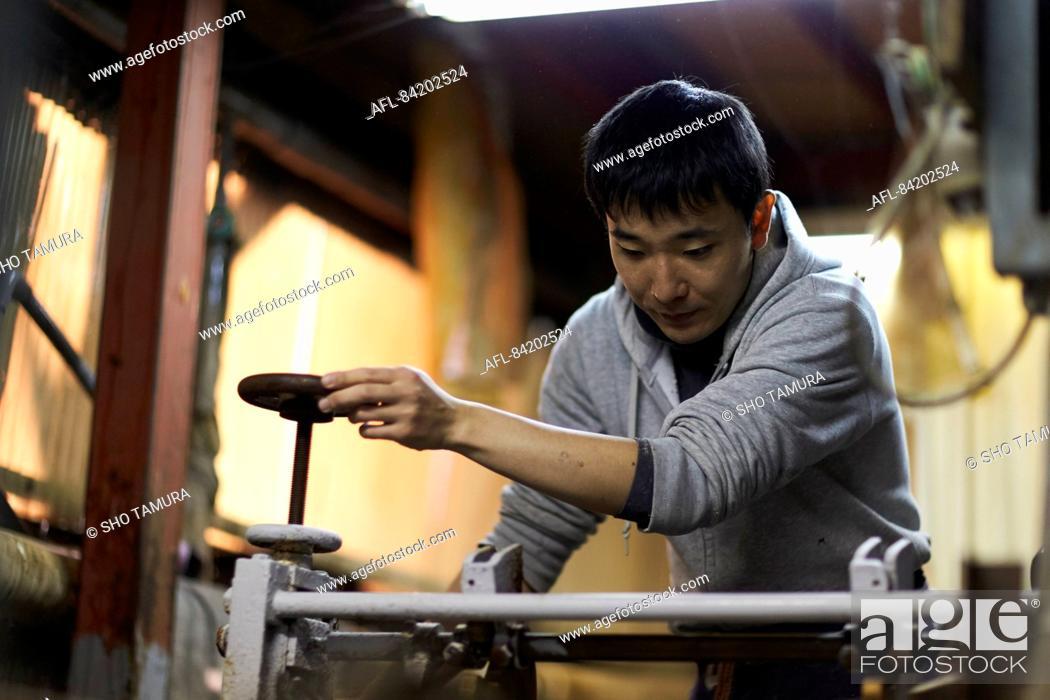 Stock Photo: Japanese artisan working in the studio.