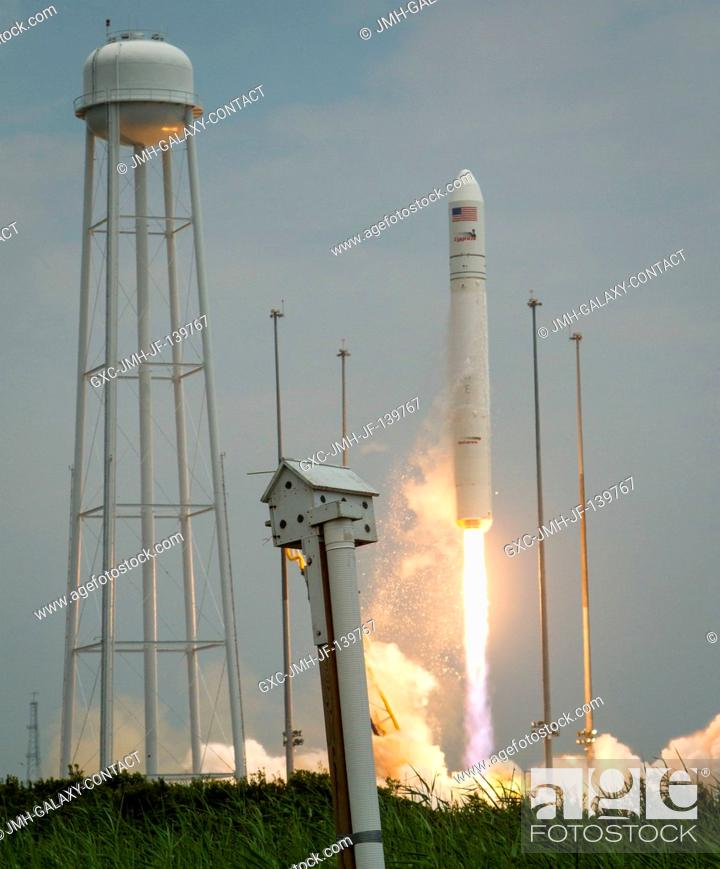 Stock Photo: The Orbital Sciences Corporation Antares rocket launches from Pad-0A with the Cygnus spacecraft onboard, July 13, 2014, at NASA's Wallops Flight Facility in.