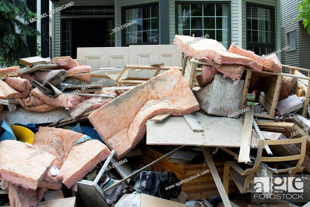 Stock Photo: Garbage And Destroyed Household Items Piled Outside A Home After A Flood; Calgary, Alberta, Canada.