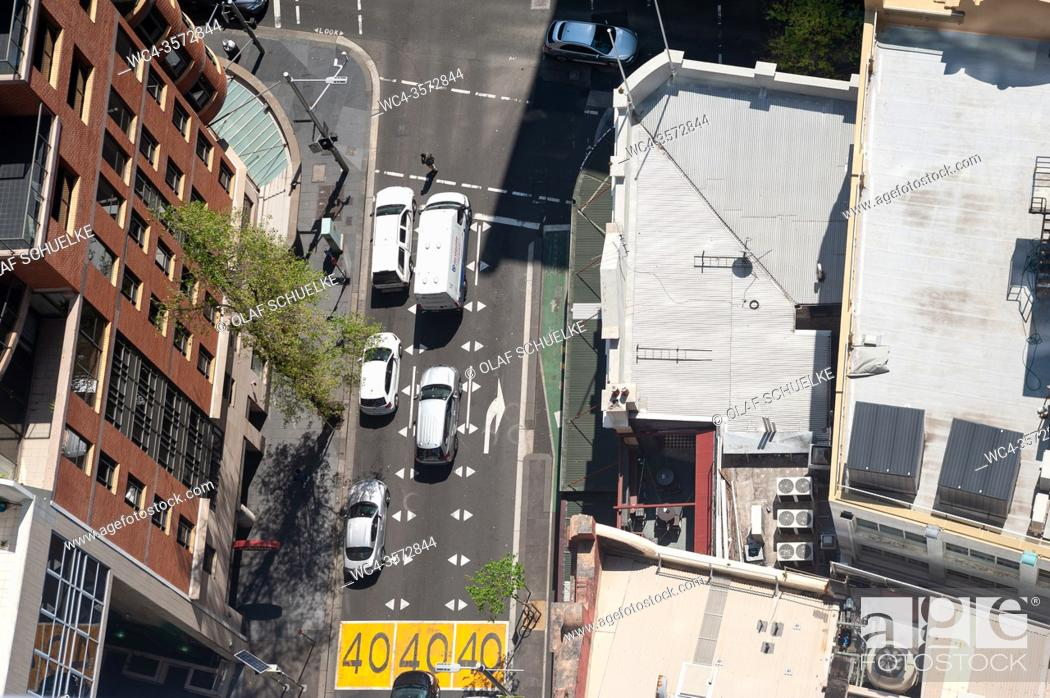 Stock Photo: Sydney, New South Wales, Australia - View from above of a street scene with waiting cars at a road junction in the city centre.