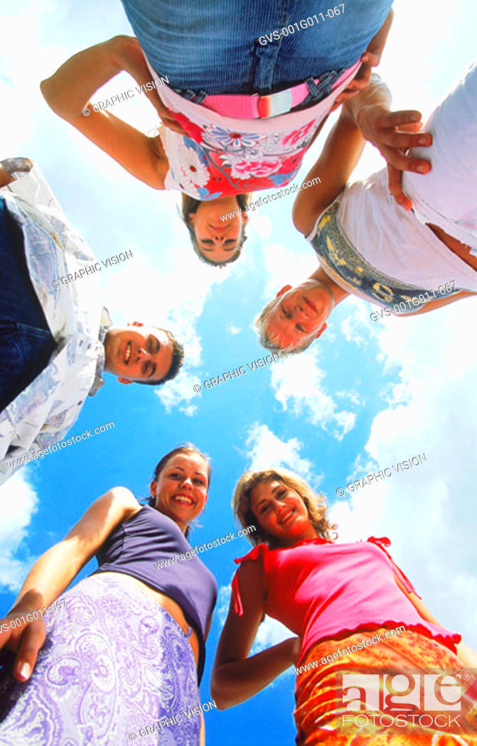 Stock Photo: Portrait of a group of young people looking down smiling.
