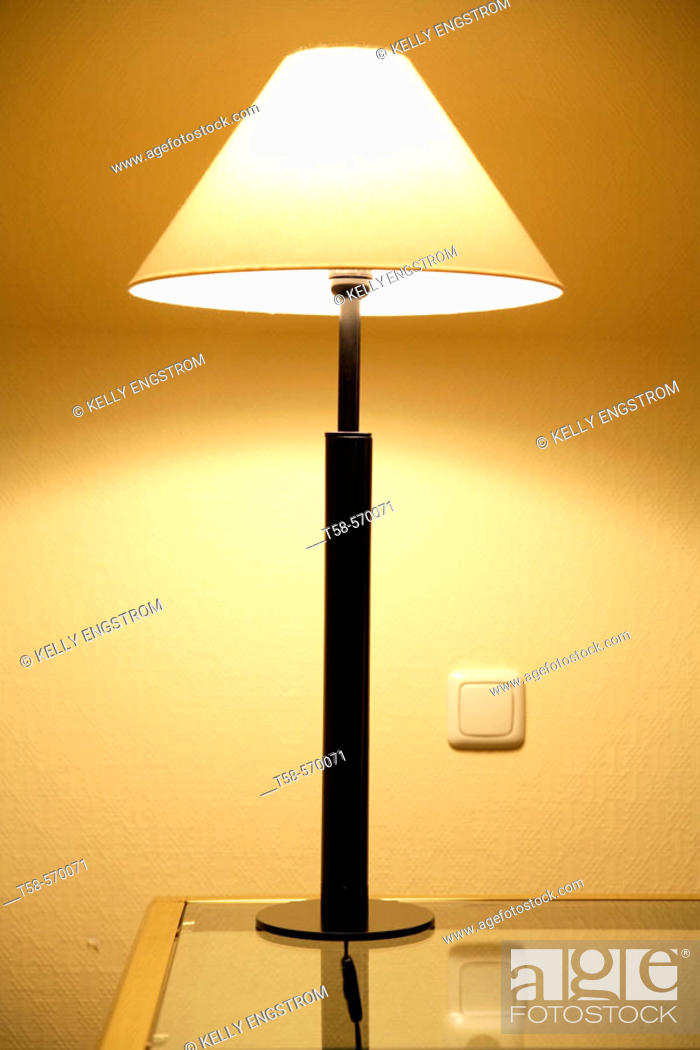 Stock Photo: shot of a lamp on a coffee table.