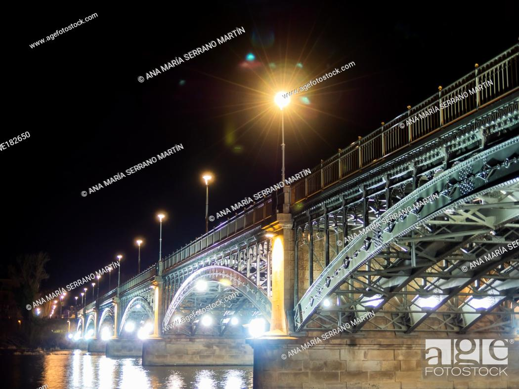 Stock Photo: Long exposure night view of the Cathedral and Enrique Estevan bridge in Salamanca (Spain).