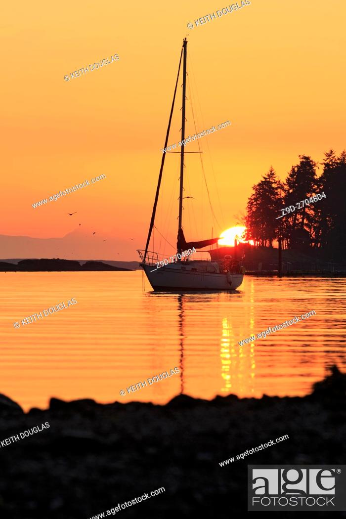 Stock Photo: Sailboat at sunrise, Departure Bay, Nanaimo, Vancouver Island, British Columbia.