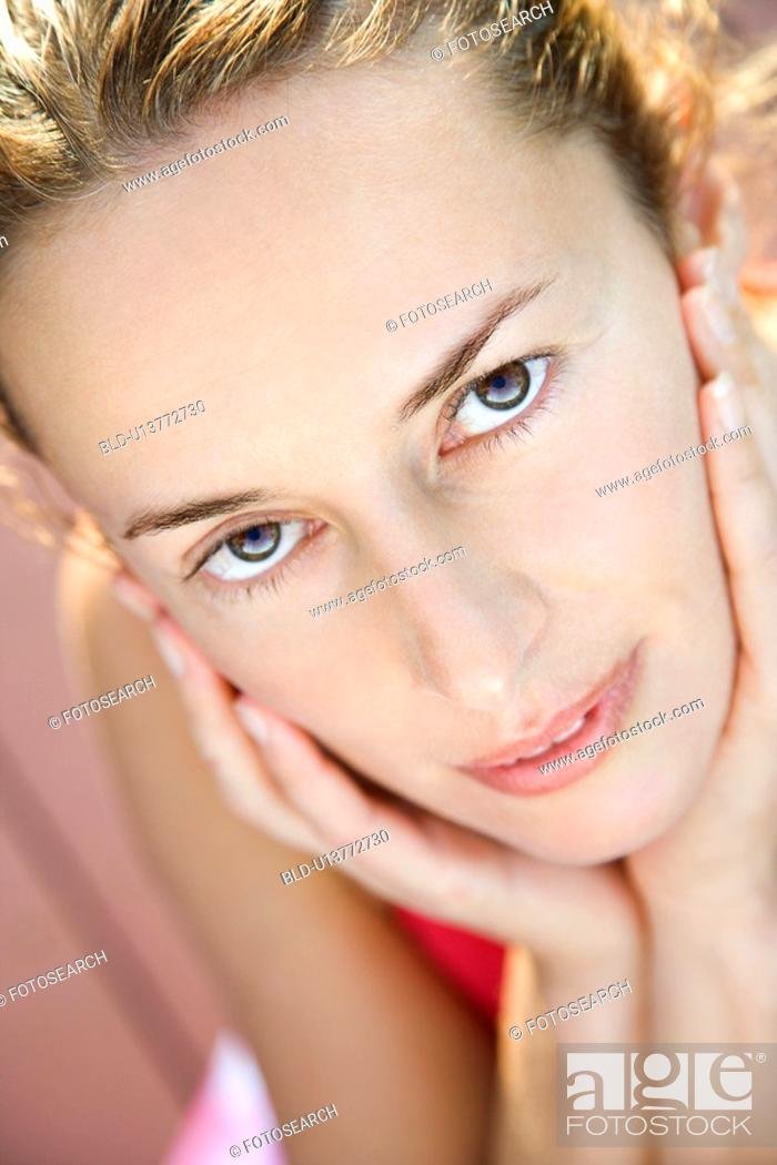Stock Photo: Close-up of Caucasian mid-adult woman looking at viewer.