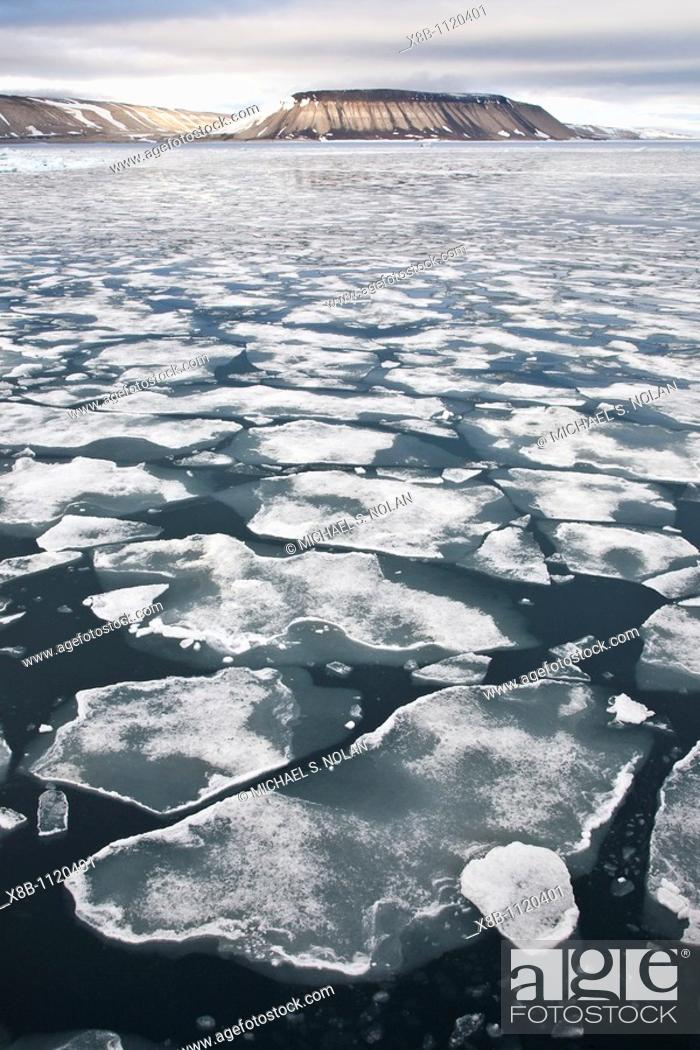Stock Photo: Open leads surrounded by multi-year ice floes in the Barents Sea between Edge¯ya Edge Island and Kong Karls Land in the Svalbard Archipelago, Norway.