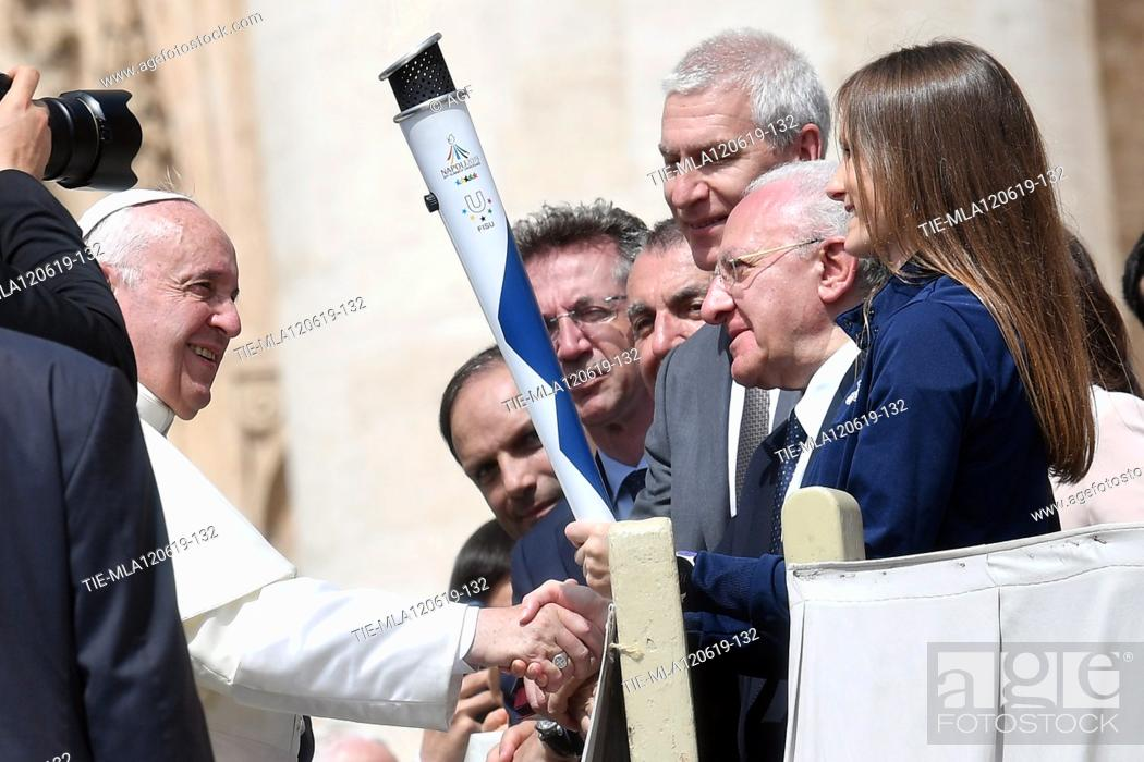 Stock Photo: Pope Francis blesses the Universiadi Napoli 2019 torch during weekly general audience, Vatican City, Italy - 12 Jun 2019.