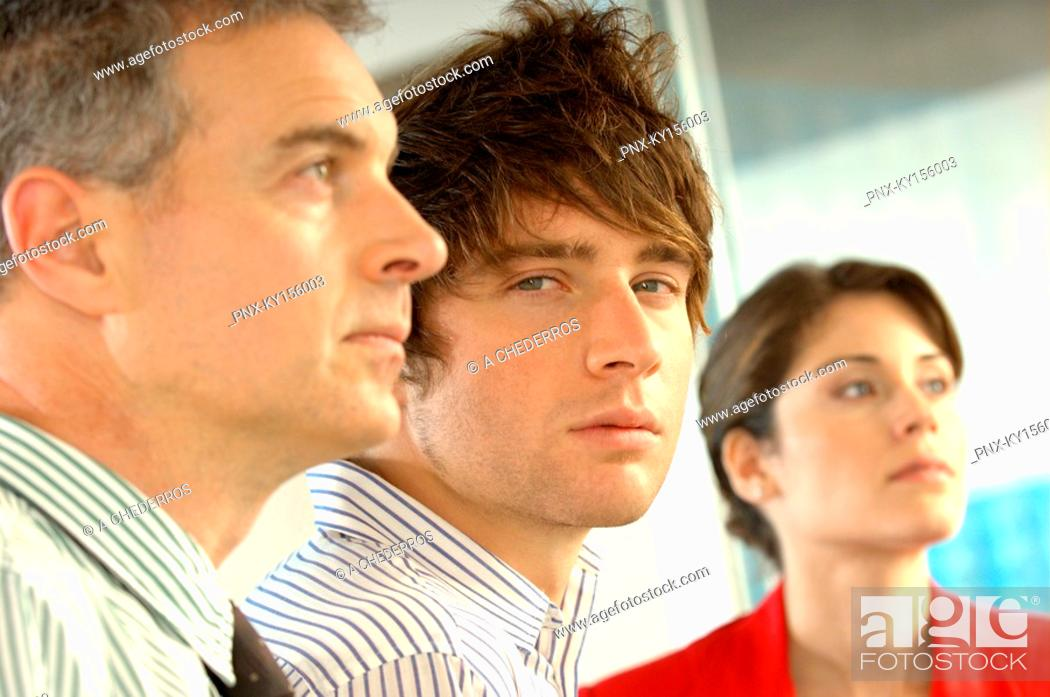 Stock Photo: Business people in office, close-up, portrait.