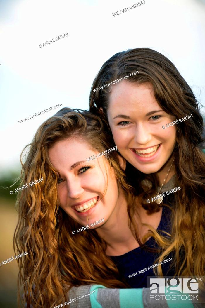 Stock Photo: USA, Texas, Sisters smiling, portrait.