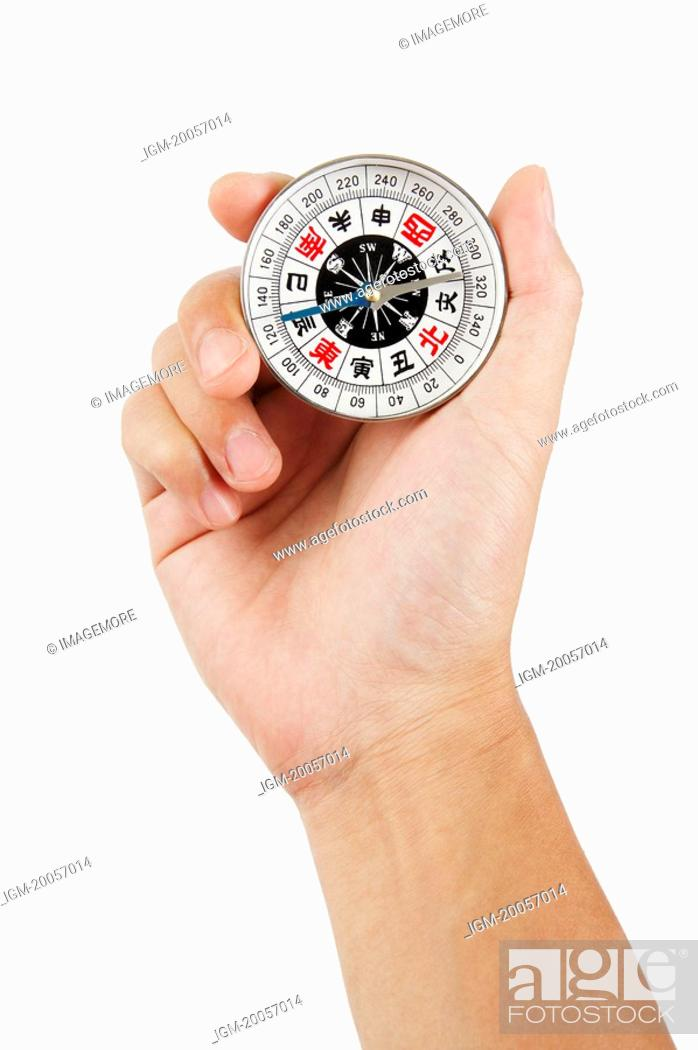 Stock Photo: Human hand holding a compass.