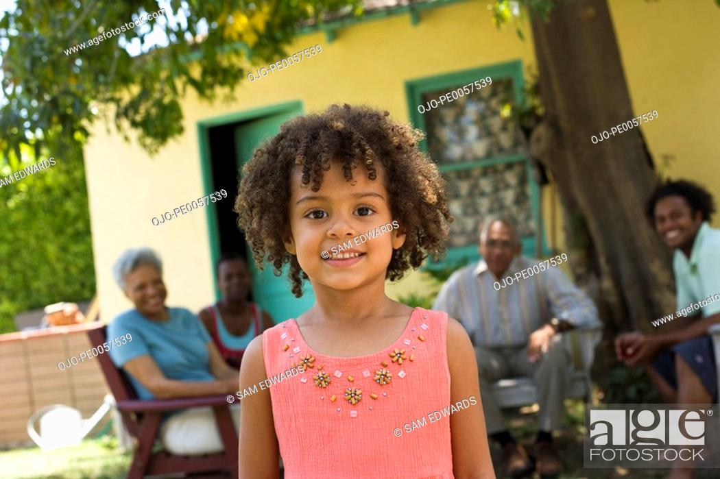 Stock Photo: Young girl with people in background.
