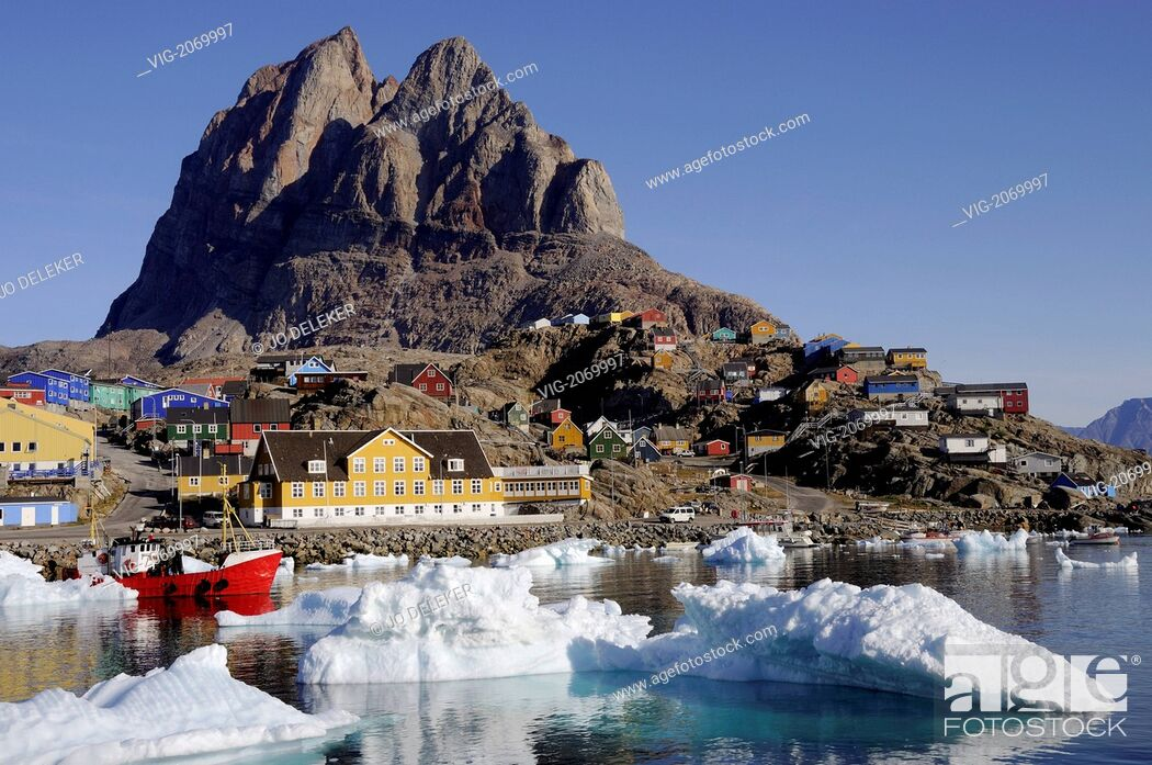 Stock Photo: red fishing vessel among icebergs in the harbour of Uummannaq, Greenland - Uummannaq, GREENLAND, 01/08/2009.