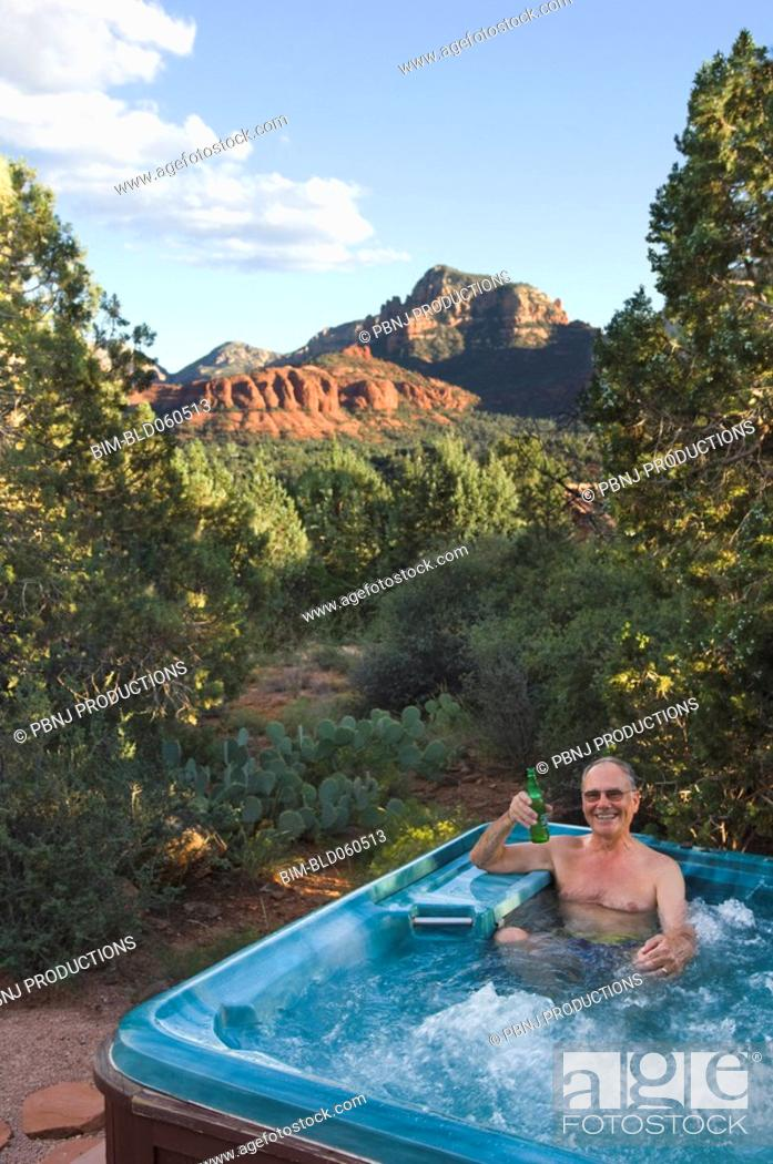 Stock Photo: Senior man in hot tub.
