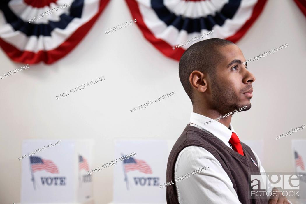 Stock Photo: Hispanic voter standing in polling place.