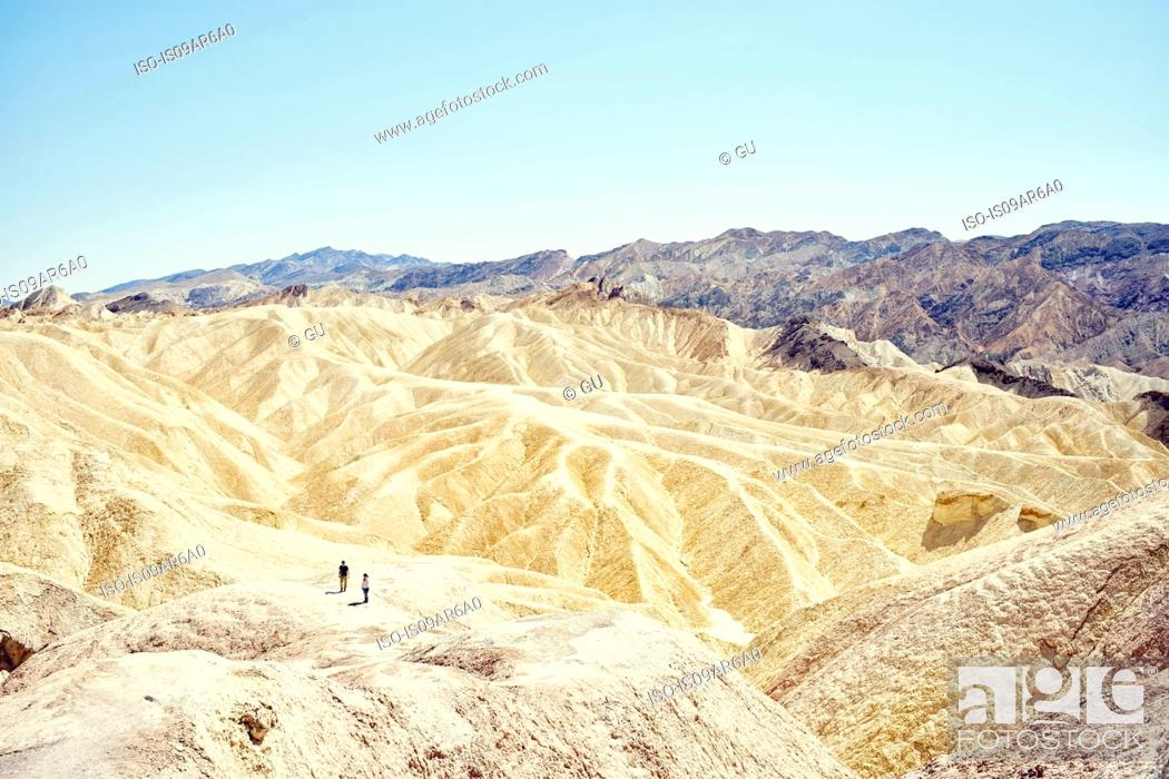 Stock Photo: View of two tourists at Zabriskie Point, Death Valley, California, USA.