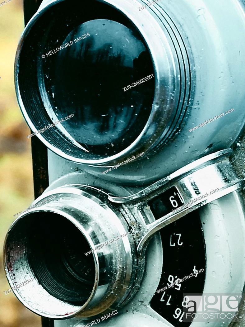 Stock Photo: Close up lenses of old retro vintage movie camera.