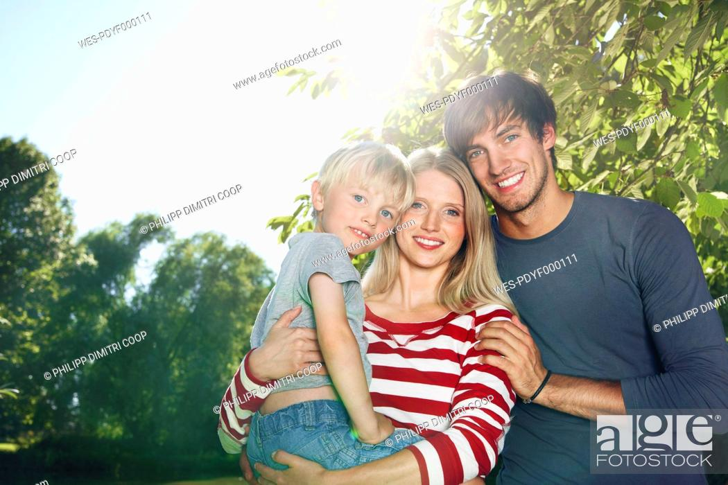 Stock Photo: Germany, Cologne, Family smiling, portrait.