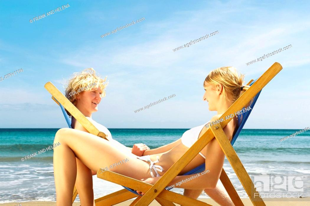 Stock Photo: Young couple sitting in sun.