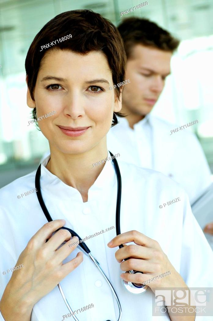 Stock Photo: Portrait of a female doctor standing with a stethoscope around her neck.