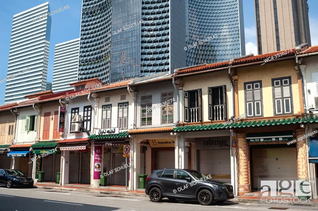 Stock Photo: Singapore, Republic of Singapore, Asia - Old buildings built in the style of traditional shophouses are towered by modern high-rise buildings in the Muslim.