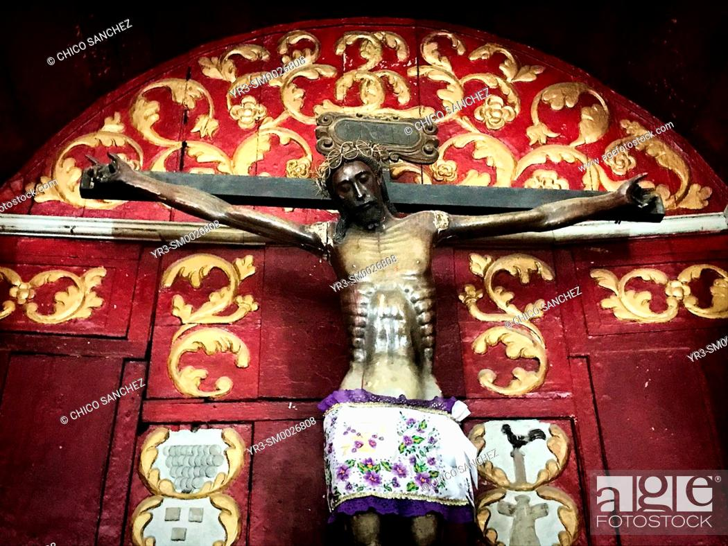 Stock Photo: An image of a black Jesus Christ crucified is displayed in an altar in the church of Ticul, Yucatán, México.
