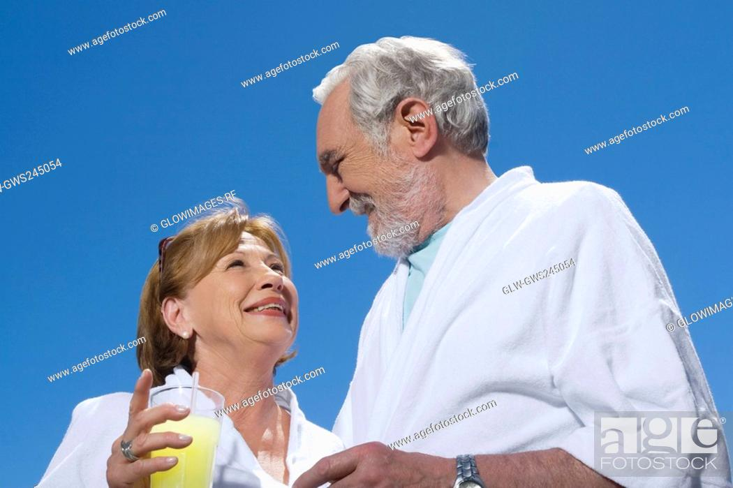 Stock Photo: Low angle view of a senior couple looking at each other and smiling.