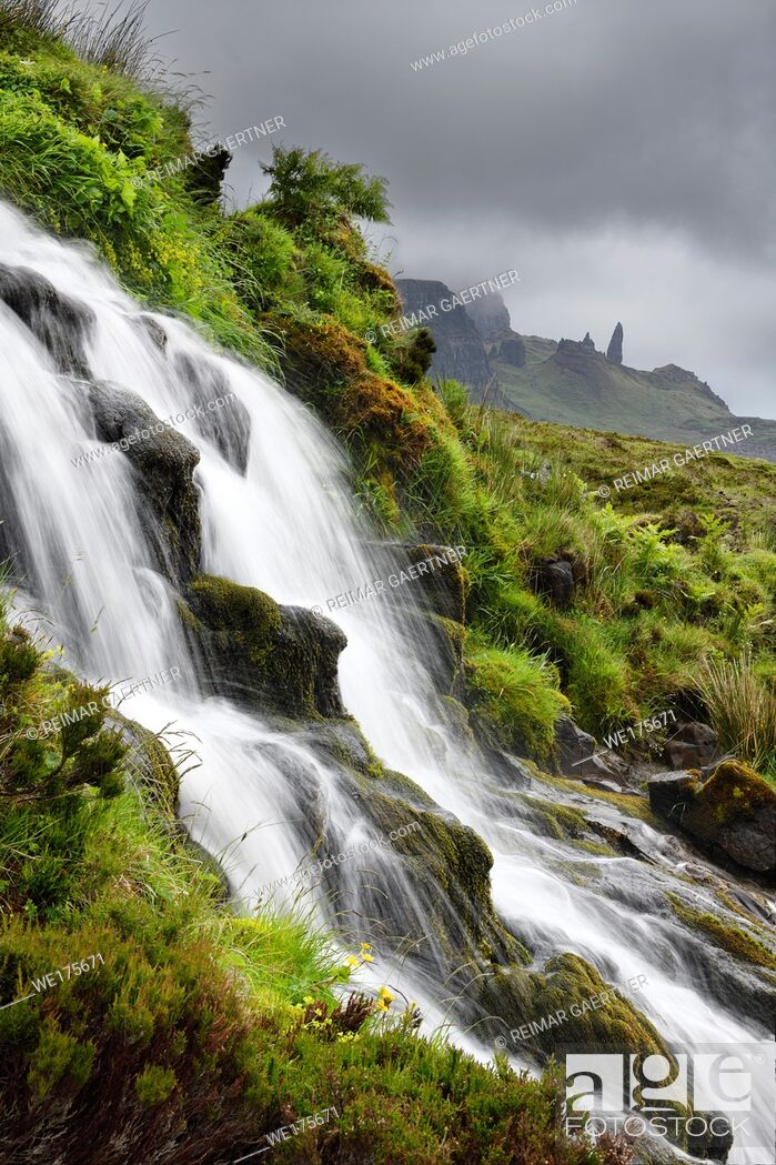 Stock Photo: Bride's Veil WaterFalls to Loch Leathan at The Storr with Old Man of Storr peak in clouds on Isle of Skye Inner Hebrides Scotland UK.