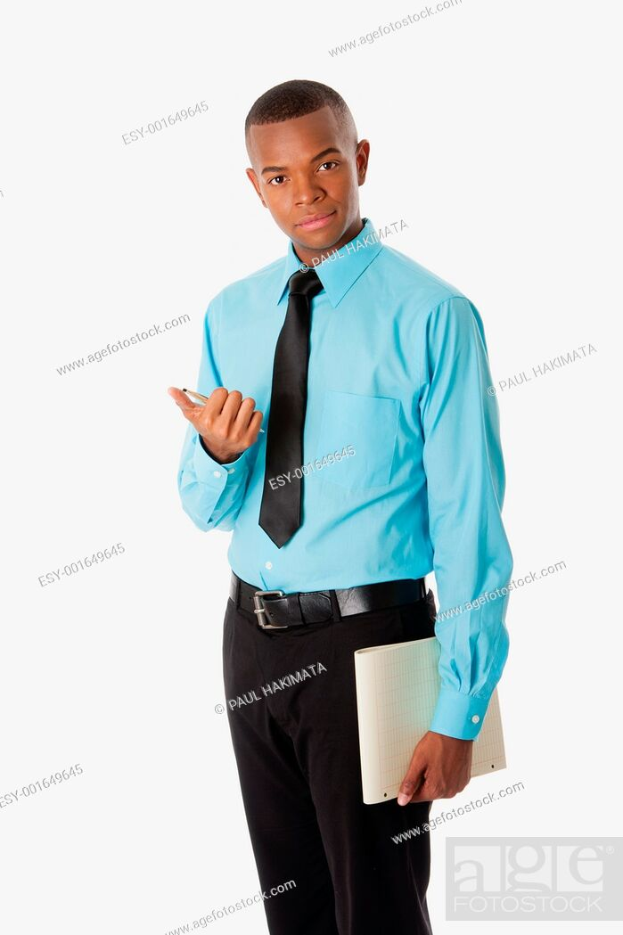 Stock Photo: Handsome happy young male corporate MBA business student in blue shirt and black tie clicking pen holding notepad, isolated.