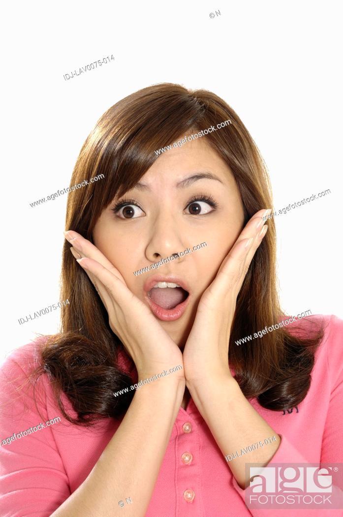 Stock Photo: Female university student looking surprised.