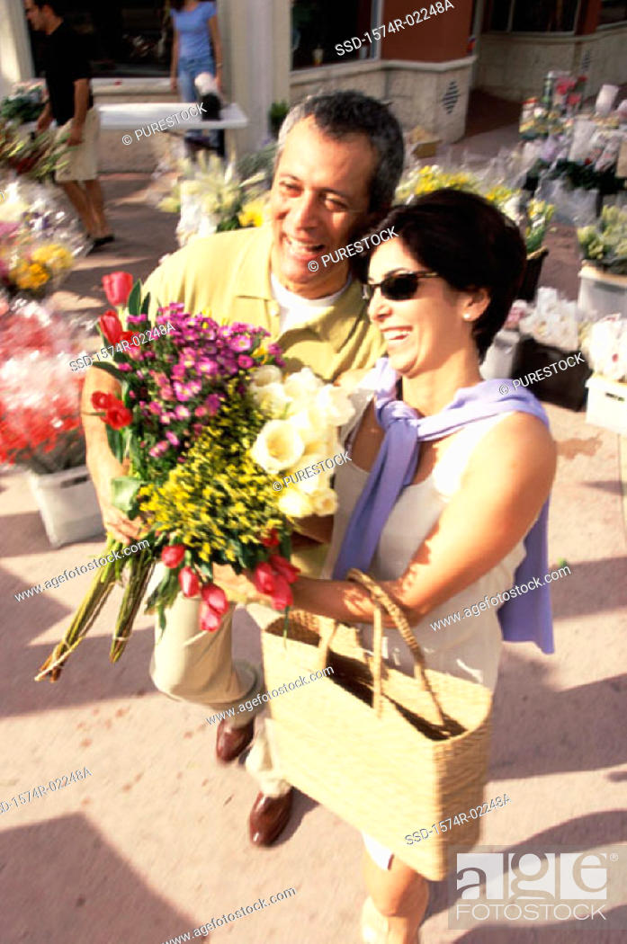 Stock Photo: High angle view of a mature couple holding a bouquet of flowers.