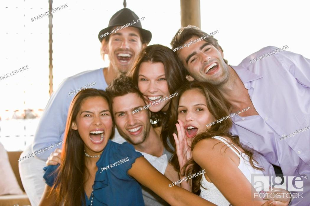 Stock Photo: Group of friends smiling together.
