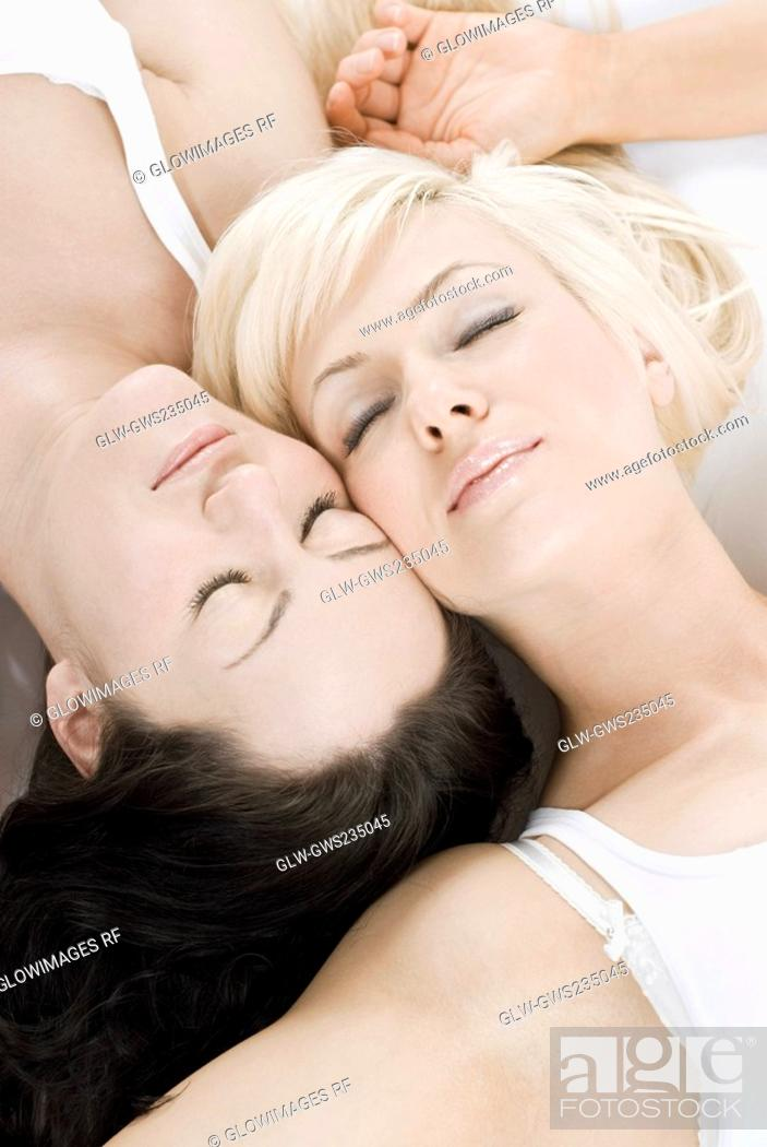 Stock Photo: Female homosexual couple lying on the bed.