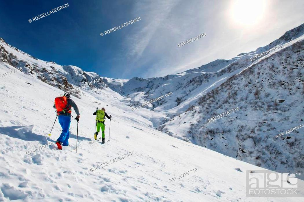 Stock Photo: Couple of friends uphill with skis and seal skins.
